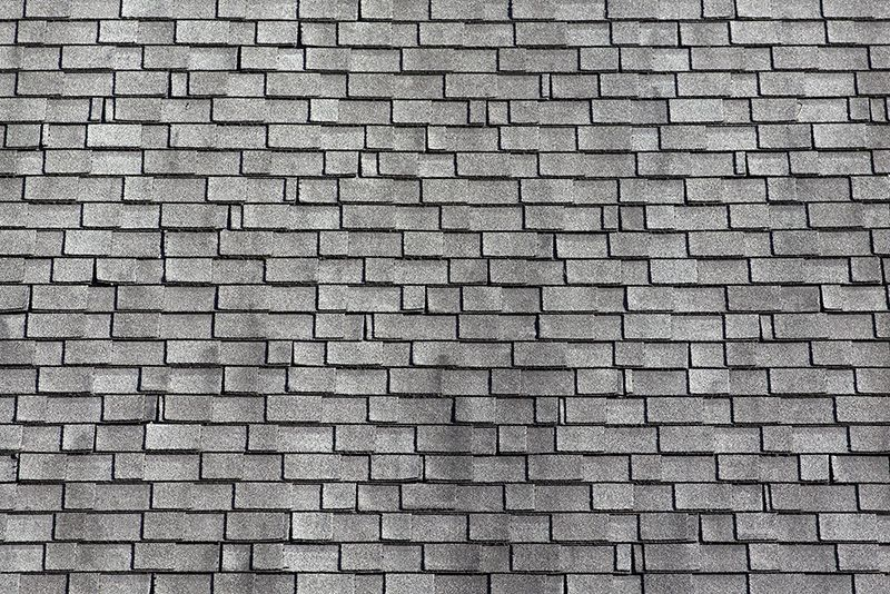 Worn asphalt shingles